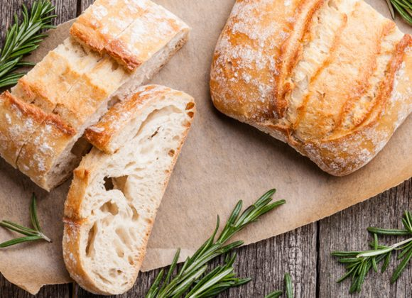 Sliced bread Ciabatta and rosemary on wooden background; Shutterstock ID 262999004; Job (TFH, TOH, RD, BNB, CWM, CM): TOH